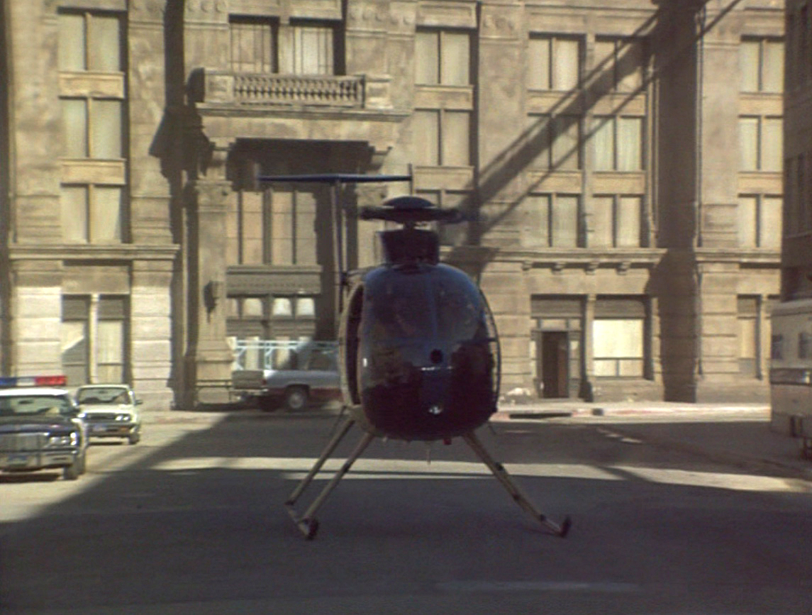 Airwolf Aerial Cameraman STAN McCLAIN (with camera on shoulder) flying with 2nd Unit Director and pilot, DAVID JONES getting the shot of Blaze dusting the crew